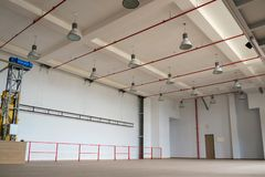 Interior of a large emty room. With lights on the celling stock photo