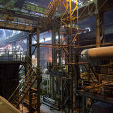Interior of large factory. Scaffolding and structure of a large industrial factory or manufacturing plant stock photography