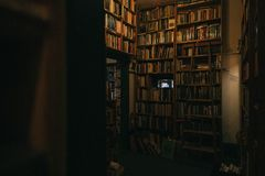 Interior of a large library with high bookshelves royalty free stock photos