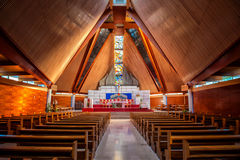 Interior of large modern catholic cathedral. With high wooden ceiling Stock Photography
