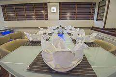 Interior of large salon dining area of luxury motor yacht Royalty Free Stock Images