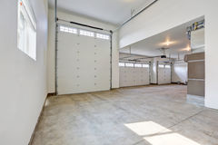 Interior of large three car garage in a brand new house Stock Images