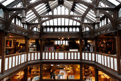 Interior of Liberty in London, UK. London, UK - August 2, 2016 - Liberty, a luxury department store in the West End of London Stock Images