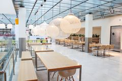 Interior of a light cafe in Europe. A modern cafe, restaurant or snack bar. Interior of the restaurant. Interior of a light cafe in Europe. A modern cafe Stock Image