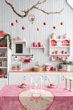 Interior light grey kitchen and red christmas decor. Preparing lunch at home on the kitchen concept. Interior light grey kitchen and red christmas decor Stock Images
