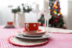 Interior light grey kitchen and red christmas decor. Preparing lunch at home on the kitchen concept. Interior light grey kitchen and red christmas decor stock image