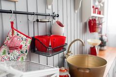 Shelves with dishes. Interior light grey kitchen and red christmas decor. Preparing lunch at home on the kitchen concept. Interior light grey kitchen and red royalty free stock photography