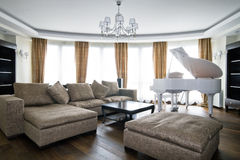 Interior of light living room with white piano Royalty Free Stock Images