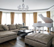Interior of light living room with white piano Royalty Free Stock Photography