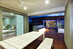 Interior ligting of a modern house with patio area at night Stock Photo