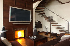 Interior of a living room. With fireplace and stair Stock Photography