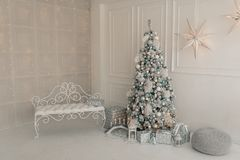 Interior living room with a Christmas tree and decorations Royalty Free Stock Image