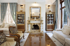 Interior of a living room with fireplace. In luxury villa Stock Photo