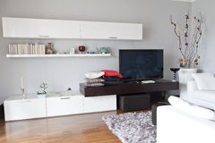 Interior of a living room, flat tv white furniture Stock Images