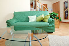Interior of living room. With green sofa and glass table stock photo