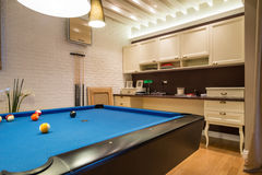 Interior of a living room with pool table.  royalty free stock photos