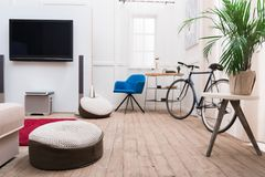 Interior of living room with TV. And bicycle royalty free stock photos