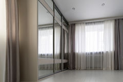 interior of living room with window and mirror wardrobe Stock Images