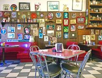 Local 50`s Diner. Interior of a local 50`s diner decorated in vintage Americana memorabilia Royalty Free Stock Images