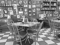 Local 50`s Diner. Interior of a local 50`s diner decorated in vintage Americana memorabilia Stock Photography