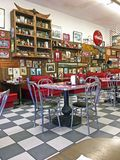 Local 50`s Diner. Interior of a local 50`s diner decorated in vintage Americana memorabilia Royalty Free Stock Image