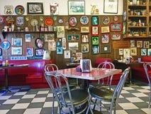 Local 50`s Diner. Interior of a local 50`s diner decorated in vintage Americana memorabilia Stock Photos
