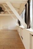 Interior loft. Interior wide loft, beams and wooden floor Royalty Free Stock Photography