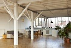 Interior loft. Interior wide loft, beams and wooden floor Stock Photos