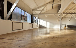 Interior loft. Interior wide loft, beams and wooden floor Stock Photography