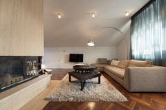 Interior of loft apartment - living room with fireplace Royalty Free Stock Photography