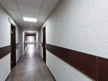 Interior - long corridor with doors Stock Images