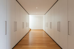 Interior, long corridor with wardrobes Royalty Free Stock Images