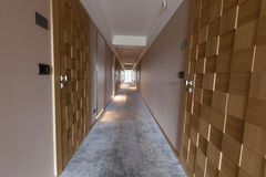 Interior of a long hotel corridor Royalty Free Stock Photography