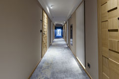 Interior of a long hotel corridor Stock Photography