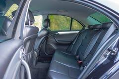 Interior lujoso alemán de la limusina - sedán, asientos de cuero Foto de archivo