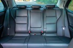Interior lujoso alemán de la limusina - sedán, asientos de cuero Fotografía de archivo