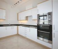 Interior luxuoso moderno da cozinha Fotografia de Stock Royalty Free