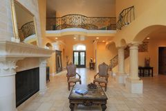Mediterranean Home. Interior or luxurious custom meridian home in the most affluent neighborhood of Sacramento area. Entrance hall, fire place, formal living Stock Photo