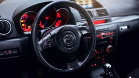 Steering wheel in modern car. Interior of luxurious sport car. modern car interior. air condition in auto. car multimedia and navigation. Interior of a modern Royalty Free Stock Image