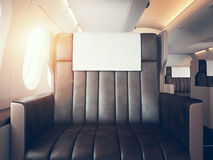 Interior of luxury airplane. Empty leather chair, sunlight. Horizontal mockup. 3d render. Photo of luxury airplane interior. Blank digital panel holding Royalty Free Stock Image