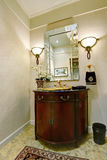Interior of luxury bathroom vanity with golden sink. Antique details. Northwest, USA Royalty Free Stock Photo