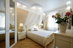 Interior of a luxury bedroom. Bedroom Interior Design. Luxury Interiors of Homes Stock Images
