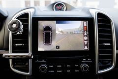 Interior of luxury car Working of front camera of circular 360 degrees view system. Image display on the head unit. Multimedia in. The car stock photos