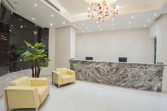 Interior of a luxury hotel lobby reception area. Interior design of a luxury hotel resort lobby reception area with seating Royalty Free Stock Images