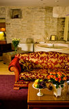 Interior of luxury hotel room. The interior view of a luxury hotel with antique furniture and a jacuzzi Royalty Free Stock Images