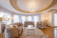 Interior of a luxury living room with round, circle, ceiling. Interior of a new luxury living room with round, circle, ceiling royalty free stock images