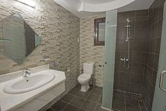 Interior of a luxury show home bathroom. Interior design of a luxury show home bathroom with shower cubicle Stock Image