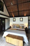 Interior of luxury tropical villa. / bedroom royalty free stock images