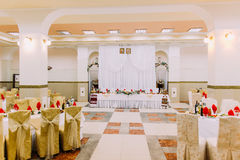 Interior of luxury wedding hall with head table in center.  Royalty Free Stock Image