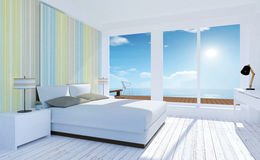 Interior mínimo blanco y acogedor del dormitorio con la opinión del mar en verano fotos de archivo libres de regalías